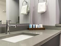 Bathroom Sink and Complimentary Products in Guest Room at Rockport Inn & Suites
