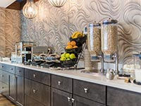 Free Breakfast Bar at Rockport Inn & Suites with Fruit, Cereal, Waffles, Coffee