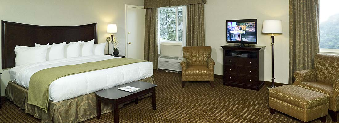 rockport inn suites hotel room king bed view 1